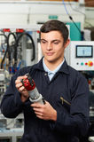 Apprentice Engineer Checking Component In Factory Royalty Free Stock Images