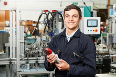 Apprentice Engineer Checking Component In Factory Stock Photography
