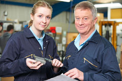 Apprentice Engineer Measuring Component With Micrometer Royalty Free Stock Images