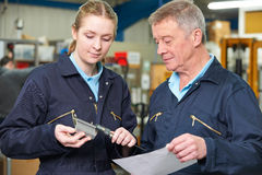 Apprentice Engineer Measuring Component With Micrometer Stock Photography