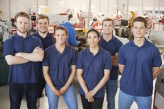 Apprentice engineers in their workplace, group portrait royalty free stock photography