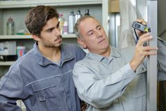 Apprentice with new boss on first day. Apprentice with his new boss on his first day stock photography
