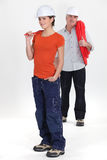 Apprentice and senior plumber Stock Images