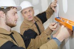 Free Apprentice Workman With Spirit Level Stock Photos - 102276183