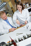 Apprentice in workshop of optician Stock Images