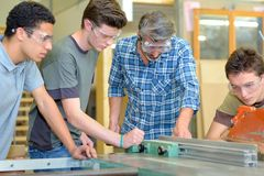 Apprentices learning a trade royalty free stock photos