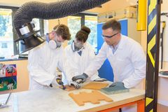 Apprentices wearing a mask stock images