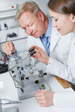 Apprenticeship in optician workshop Stock Image