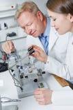 Apprenticeship in optician workshop Stock Image