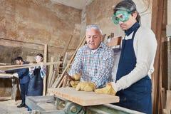 Apprentissage de traitement de bois Images stock
