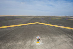 Approach light on a airport runway. Approach light at the start of an airport tarmac runway with chevrons stock images