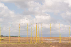 Approach light bar at runway threshold. On the brown grass Stock Image