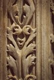 Approach of a piece of carved marble. Spent by the passage of time. Simulates interlaced leaves forming a repetitive pattern Stock Photography
