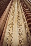 Approach of a carved column. Spent by the passage of time. Simulates interlaced leaves forming a repetitive pattern. Approach of a piece of carved marble. Spent Stock Image