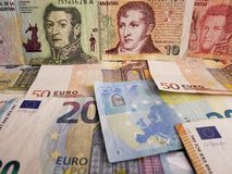 Approach to argentine banknotes and euro bills. Argentinean banknotes and euro bills. european bills of  denominations, background, commerce, exchange, trade stock image