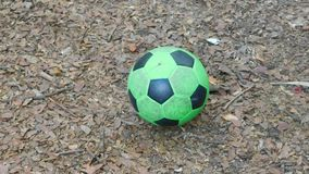 Approach to a green soccer ball stock video footage