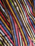 Approach to a multicolored mexican rebozo with stripes, background and texture. Backdrop for mexican celebrations and traditions of the month of september stock image