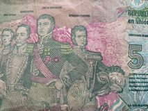 Approach to reverse side of an argentinean banknote of five pesos, background and texture. Backdrop for announcements of trading and exchange, bank and commerce royalty free stock photos