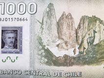 Approach to reverse side of chilean banknote of 1000 pesos, background and texture. Backdrop for announcements of trading and exchange, bank and commerce, price royalty free stock photos