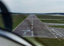 Approach to the runway of Braunschweig Airport from the pulpit of a two-seater small aircraft. Germany royalty free stock photography