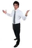 Approachable business man. Approachable young business man with open arms isolated Royalty Free Stock Photography