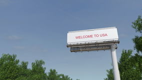 Approaching big highway billboard with Welcome to USA caption stock video