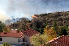 Approaching Brushfire. Brushfire approaching a home in southern California royalty free stock images