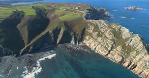 Approaching from cliffs in aerial view of the coast. With fieldson the top of the cliffs in the north of Spain stock video