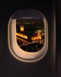 Approaching destination London. UK, jet plane window night view Stock Image