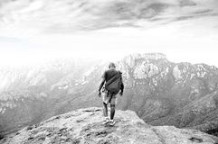 Approaching the Edge. Young black man approaching edge of a cliff Royalty Free Stock Photography