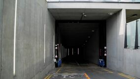 Approaching the entrance of an underground parking garage tunnel
