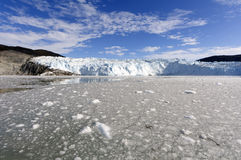 Approaching the Eqi Glacier. Very few places in Greenland are as beautiful as the Eqi glacier 70 km north of Ilulissat in the Disco Bay. The Eqi glacier is one Royalty Free Stock Photo