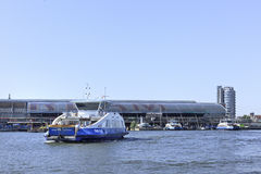 Approaching ferryboat in Amsterdam. Royalty Free Stock Photography