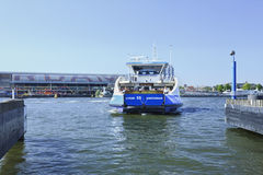 Approaching ferryboat in Amsterdam. Stock Photos