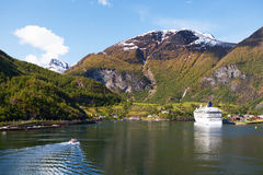 Approaching Flam, Norway. A tender from a cruise ship approaches the Norwegian town of Flam on the Aurlandsfjord Stock Photo