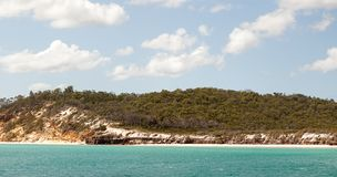 Approaching Fraser Island near Hervey Bay Australia. View of worlds largest sand island, Fraser Island near Hervey Bay Australia royalty free stock photo