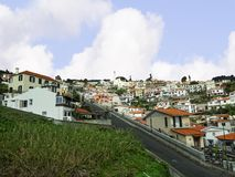 Approaching Funchal from the Airport on the island of madeira. Funchal is the Capital of the island of Madeira. The distinctive houses and rooves seem to pile on Stock Photo