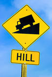 Approaching hill sign along highway Royalty Free Stock Image