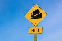 Approaching hill sign along highway royalty free stock images