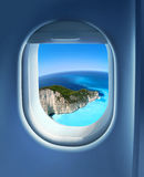 Approaching holiday destination. Approaching paradise island holiday destination, jet plane window sky view Stock Image