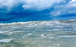 Approaching huge wave in the blue cold sea or ocean. Tsunami, storm hurricane. Close-up royalty free stock photo