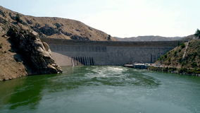 Approaching a Hydroelectric Dam from down stream stock footage