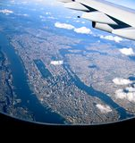Approaching Manhattan New York. Manhattan in the evening sun from 10.000 feet Stock Photo