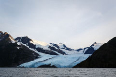 Approaching Portage glacier from lake in Alaskan wilderness in summer Royalty Free Stock Photos
