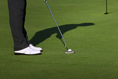 Approaching the Putt. Professional golfer are thinking for the shoot Stock Photos