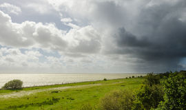 Approaching rainshower in spring, Friesland, The N Stock Images