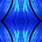 Approaching the stained glass in blue colors, with symmetry and reflection effect, background and texture. Backdrop for color ads, creative pattern and geometric stock photography