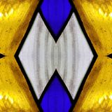 Approaching the stained glass in blue, yellow and white colors, with symmetry and reflection effect, background and texture. Backdrop for color ads, creative stock photo
