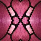 Approaching the stained glass in red and pink colors, with symmetry and reflection effect, background and texture. Backdrop for color ads, creative pattern and stock illustration