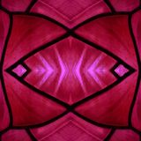 Approaching the stained glass in red and pink colors, with symmetry and reflection effect, background and texture. Backdrop for color ads, creative pattern and royalty free stock photography